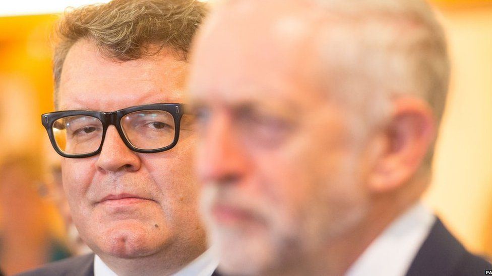 Labour Deputy Leader Tom Watson (left) watches as Labour Leader Jeremy Corbyn (right) speaks to the media