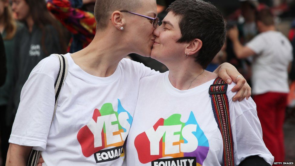 People celebrate as same sex marriage has been legalised in Australia