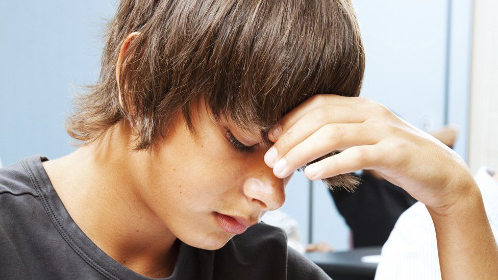 Young man sitting an exam