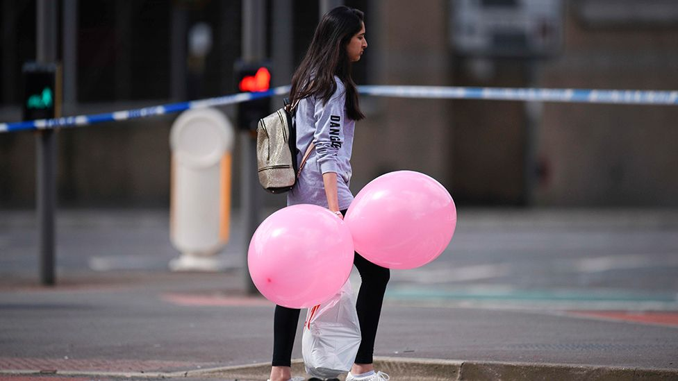 Young woman carrying balloons near the Manchester Arena attack