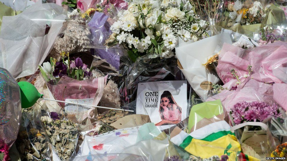 Tributes and flowers have been left in St Ann's Square in Manchester