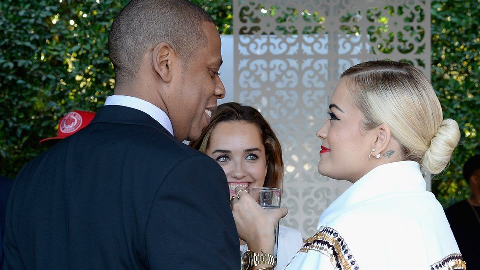 Jay Z and Rita Ora at a pre-Grammys event in 2014