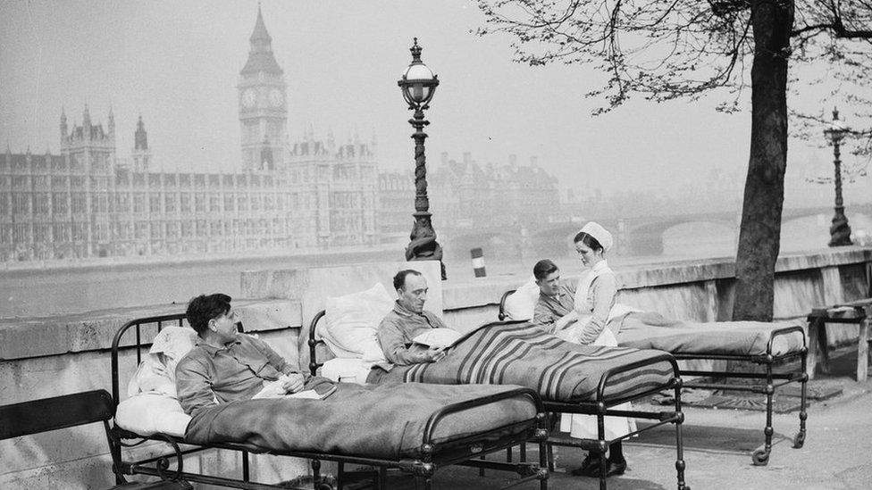 patients in beds by the houses of parliament