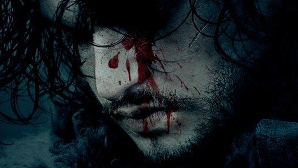 The character of Jon Snow with bloody on his face