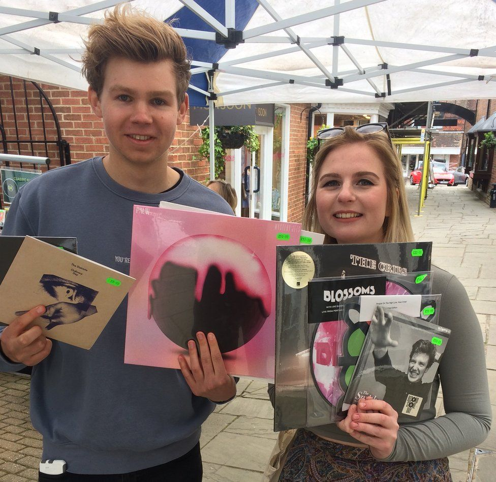 Amy and Michael pose with their vinyl haul