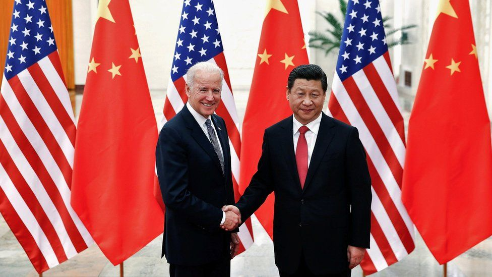 File photo of then-VP Joe Biden with Xi Jinping