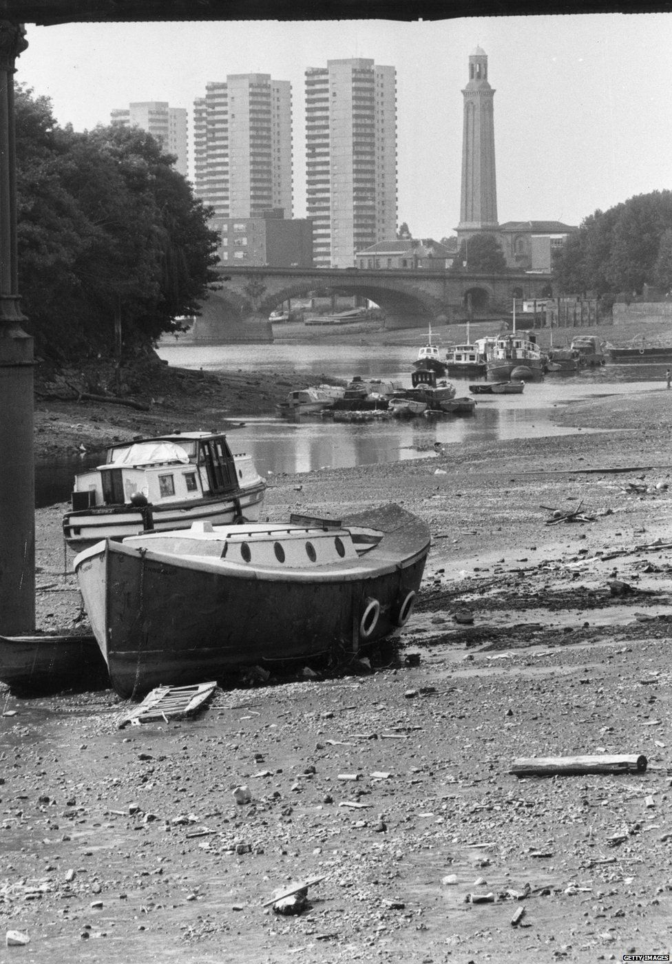 Boats are stranded on the River Thames at Strand-on-the-Green near Kew