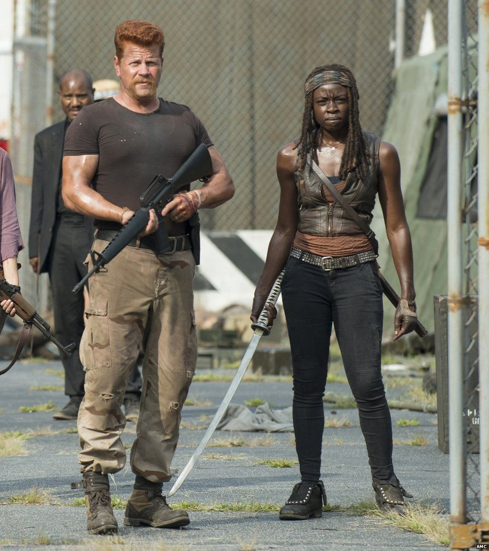 Michael Cudlitz portrays Abraham, left, and Danai Gurira portrays Michonne