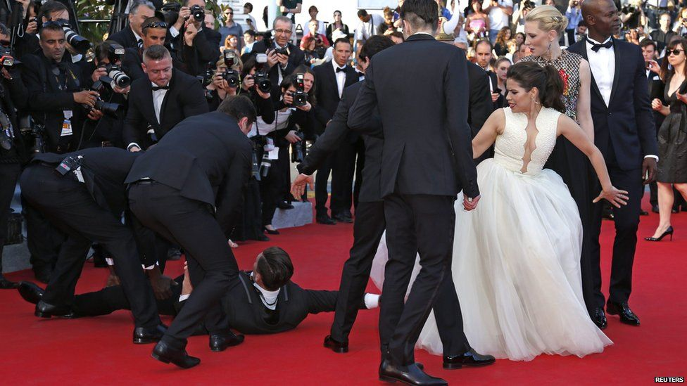 Vitalii Sediuk was arrested after he tried to slip under the dress of actress America Ferrera at the Cannes Film Festival 2014