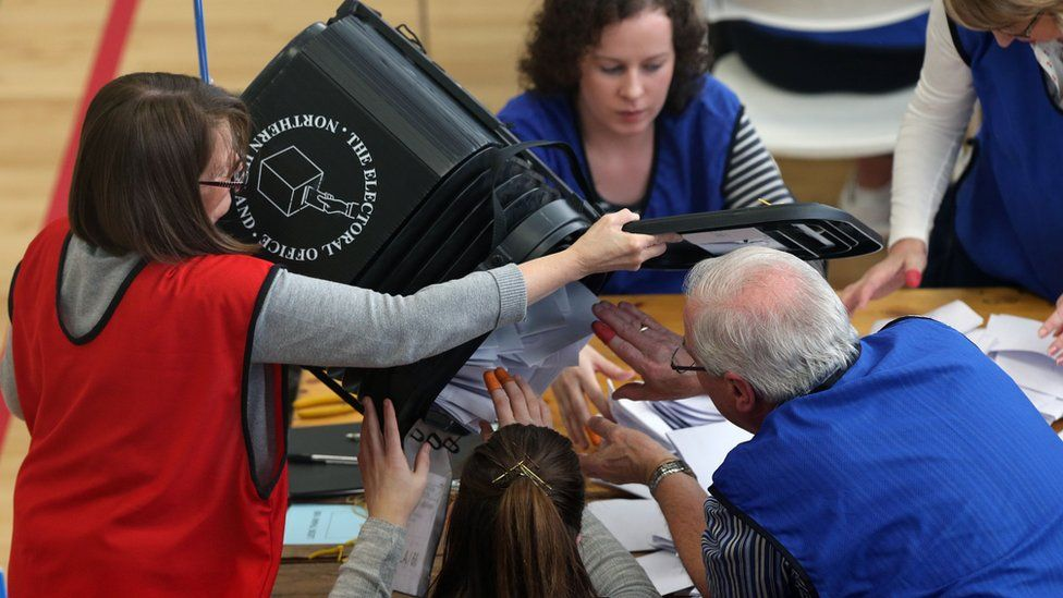 Counting staff at a centre in Londonderry begin the counting of votes