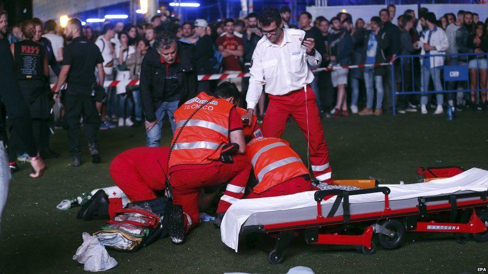 Paramedics treat Pedro Aunión Monroy