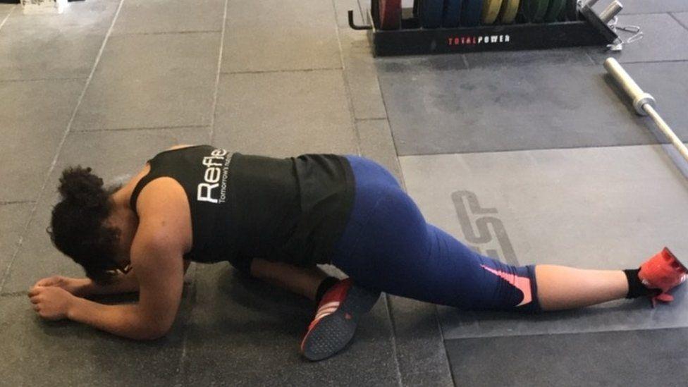 Zoe Smith stretching