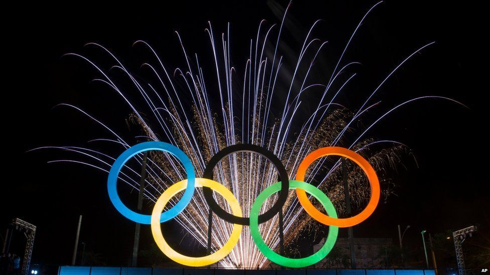 In this May 20, 2015 file photo, fireworks explode behind the Olympic rings during their inauguration ceremony at Madureira Park in Rio de Janeiro, Brazil.