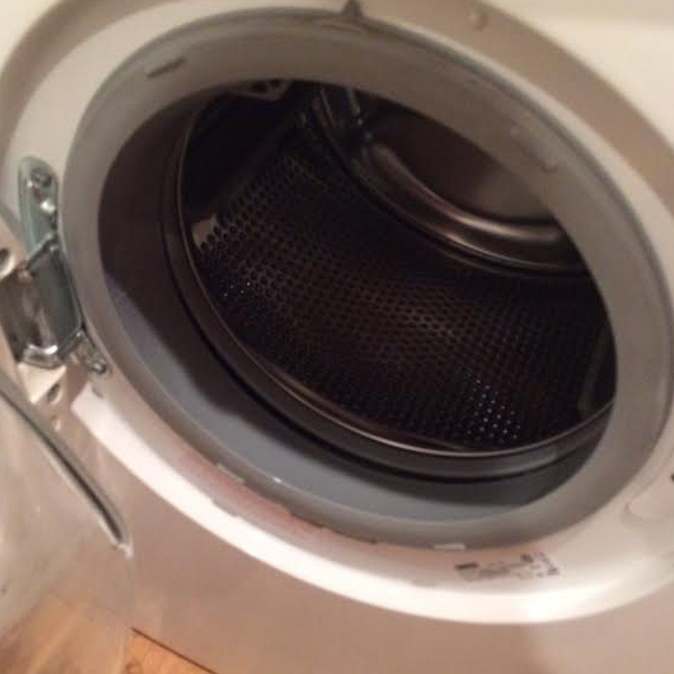 how to put a washing machine back on track