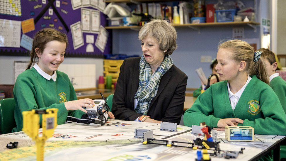 Theresa May in a school