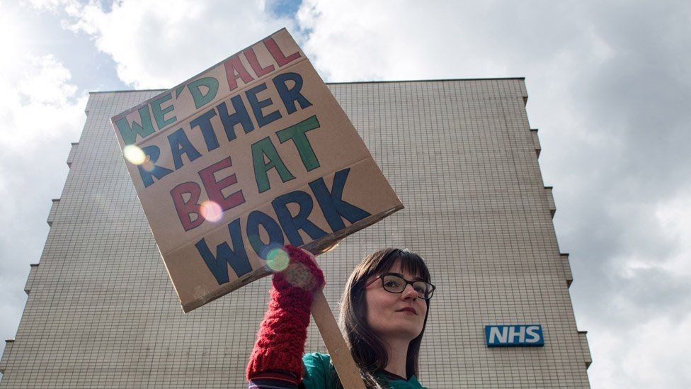 Junior doctor holding a placard