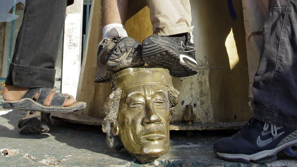 The Gaddafi statue is torn down in Tripoli in Libya on 23rd August 2011.