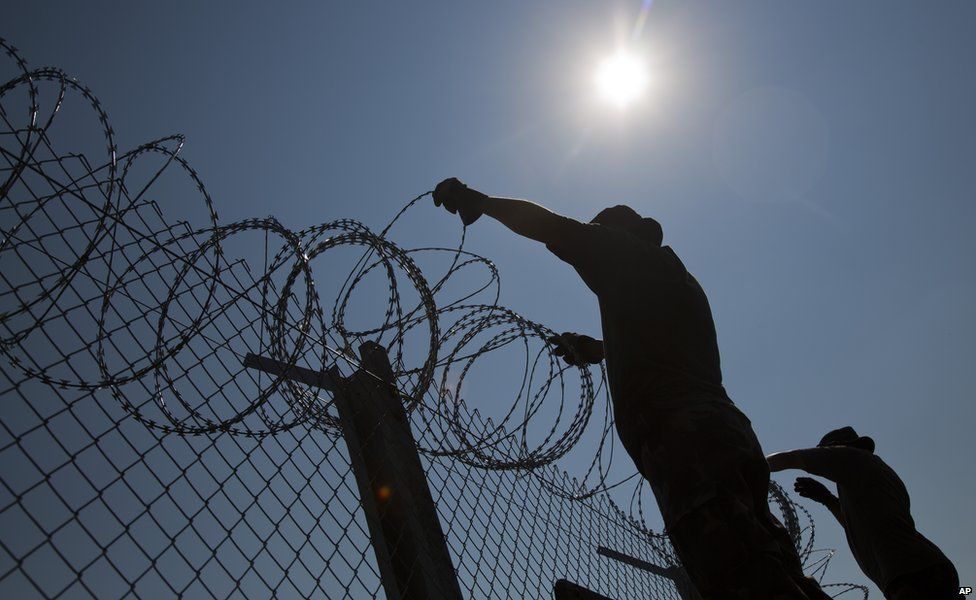 Razor wire on top of a fence on Hungary's border with Serbia and Romania