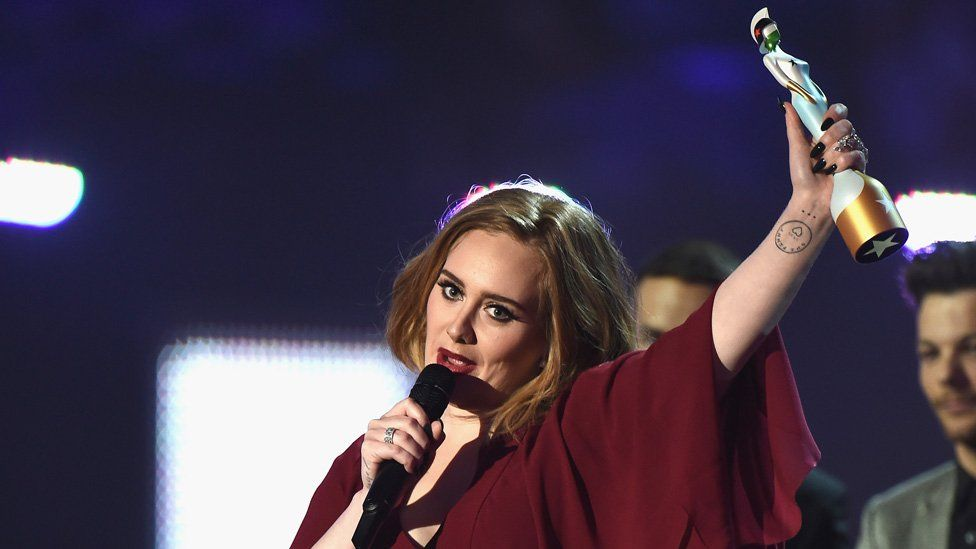 Adele wins her first trophy of the evening - British Female Solo Artist