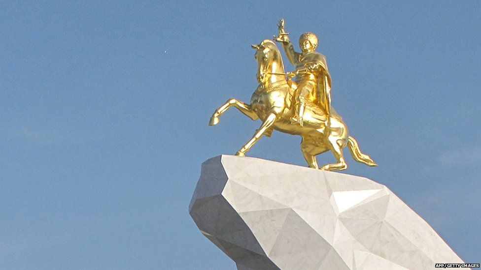 Giant gold statue of President Gurbanguly Berdymukhamedov on a horse