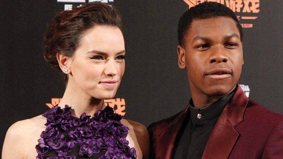 Daisy Ridley and John Boyega at a Star Wars event in December 2015