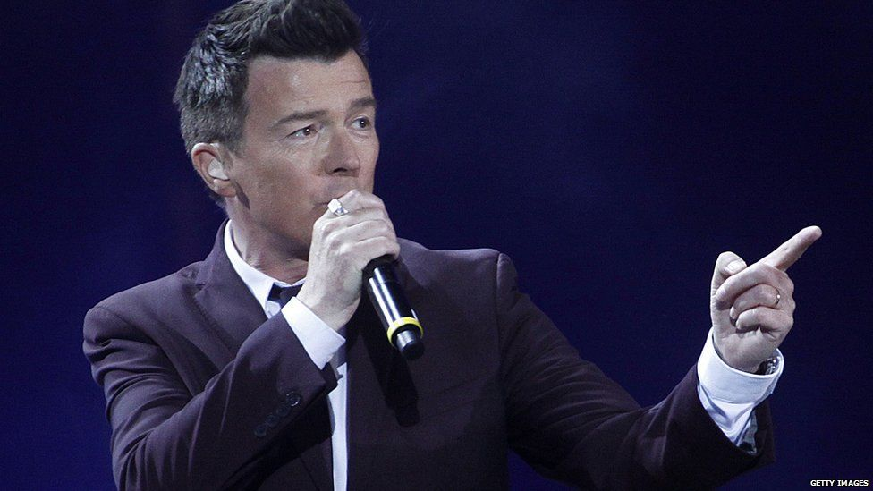 Rick Astley pointing over there.