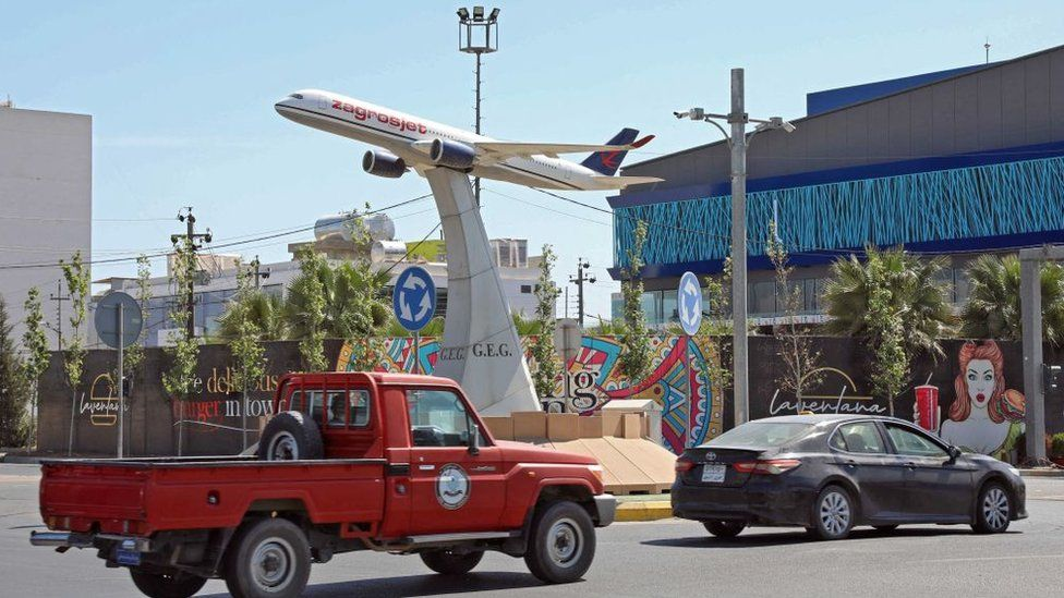 The model of a Zagrosjet passenger plane in the centre of a roundabout, near Irbil's international airport, the day after it was attacked with what the US said was an Iranian-made drone (15 April 2021)