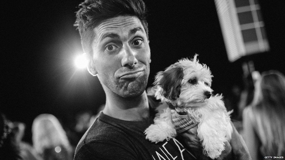 Nev with a rescue puppy on the red carpet at last year's MTV Awards