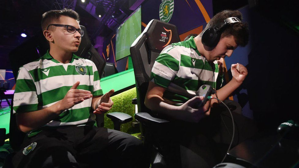 Two players from Portuguese football club Sporting's e-sports team