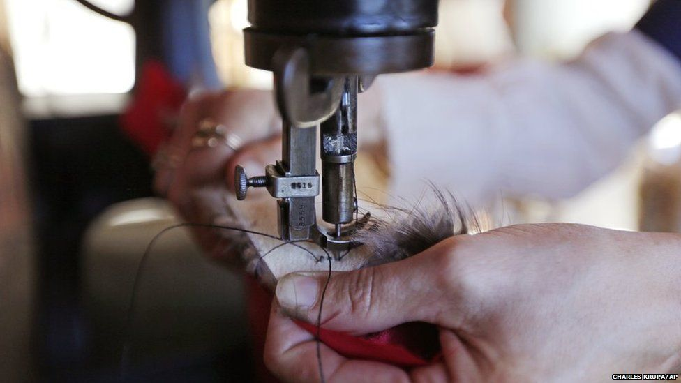 Sewing machine needle going through fur
