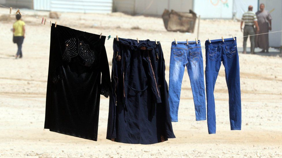 Clothes on a washing line in a Jordanian refugee camp