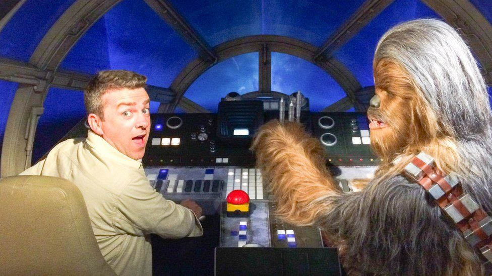 Journalist Chris Smith in the cockpit of the Millennium Falcon