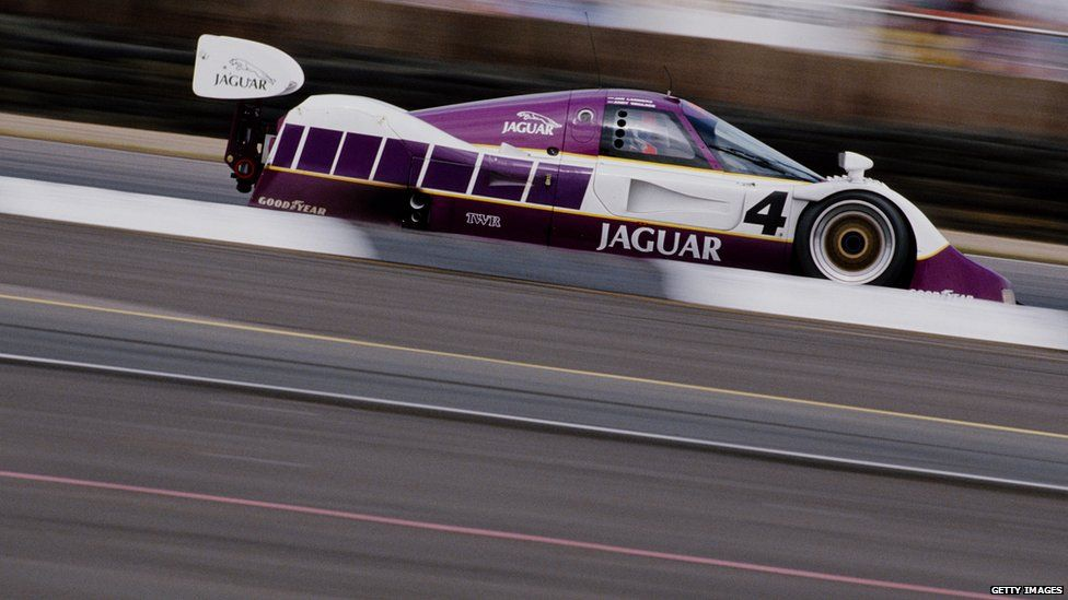 A Jaguar car on a racetrack