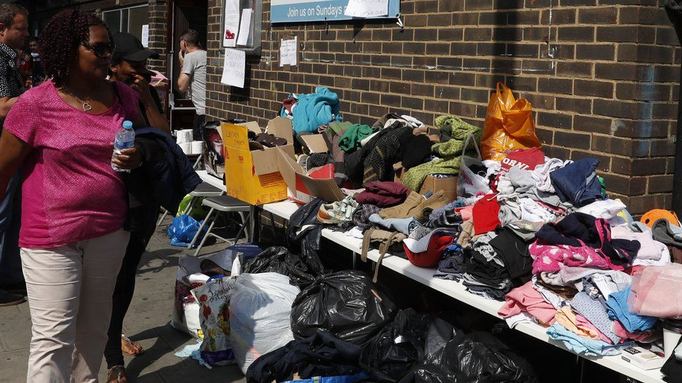 People look at the clothes donated outside a rescue centre