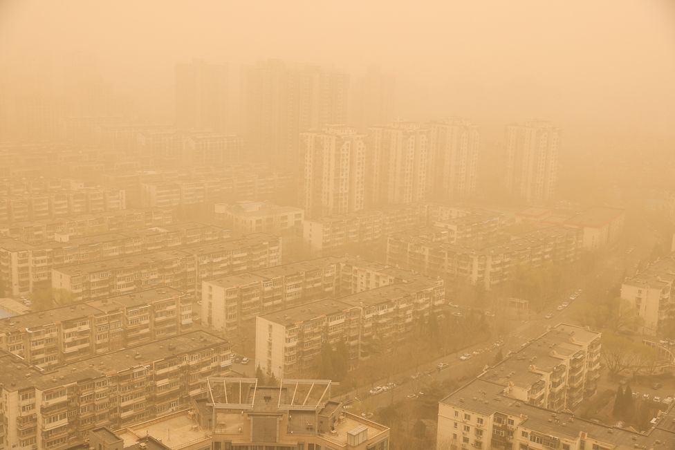 Buildings are seen during a sandstorm on 15 March 2021 in Beijing