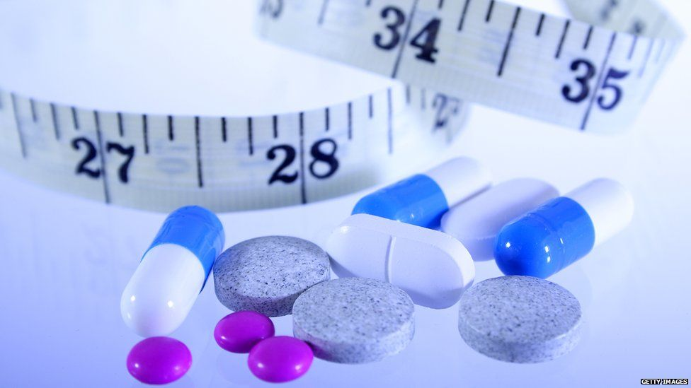 Pills and a tape measure