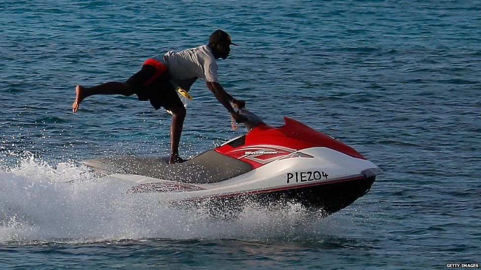 a man jetskiing