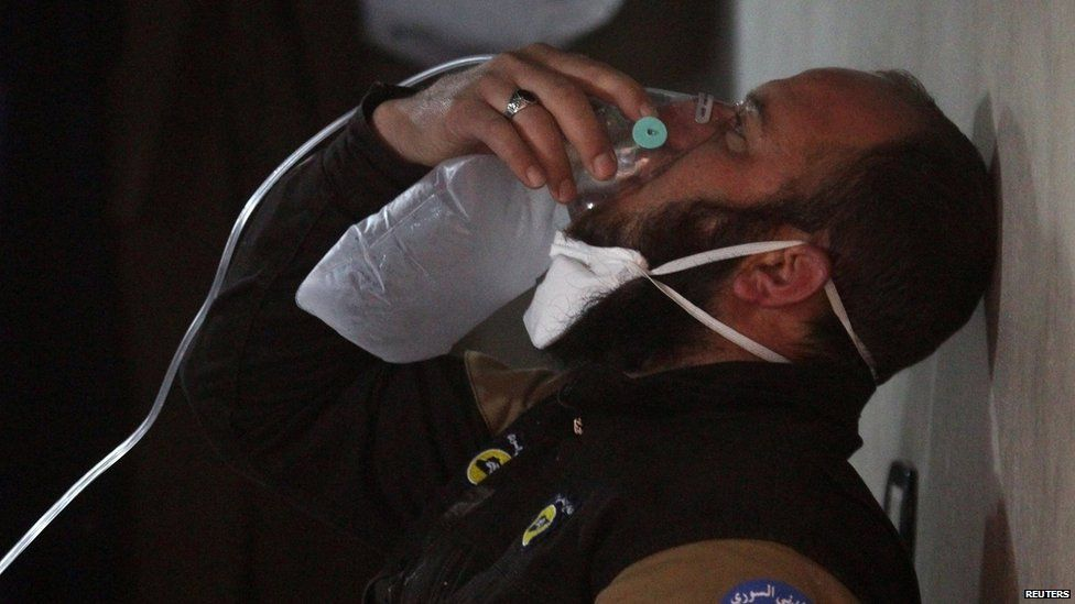 A civil defence member breathes through an oxygen mask, after a suspected gas attack in the town of Khan Sheikhoun in rebel-held Idlib, Syria