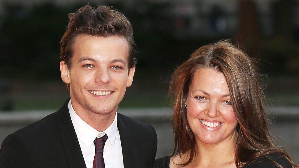 Louis Tomlinson and his mum