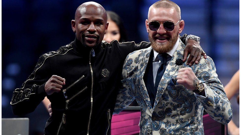Floyd Mayweather and Conor McGregor pose for a picture after fight