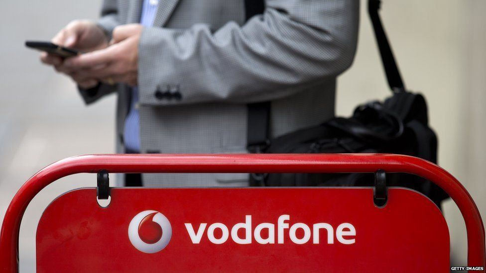 Vodafone logo with a man in the background