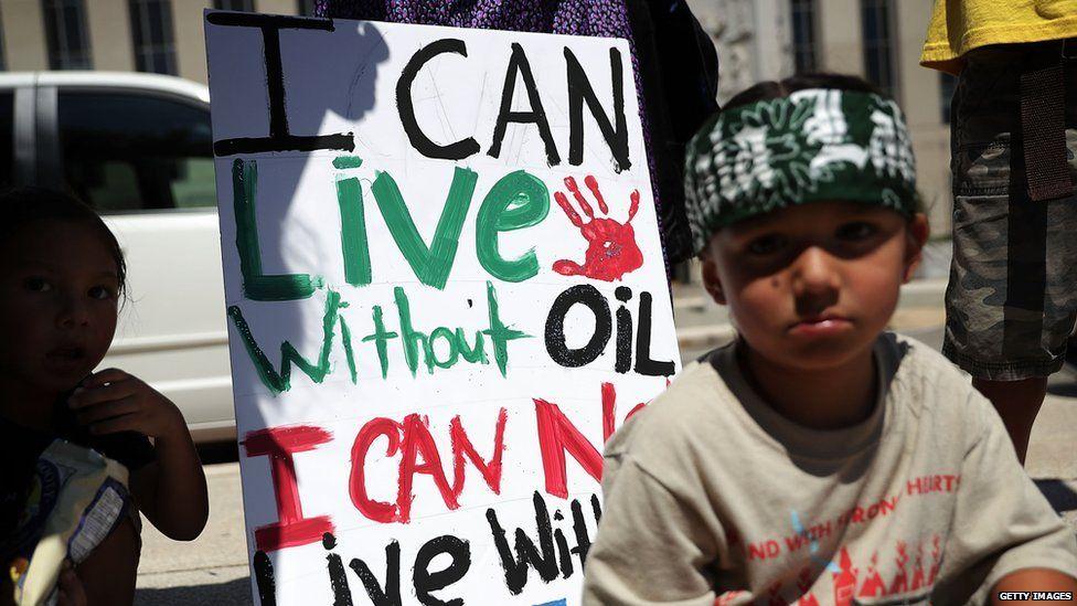 Little boy protesting the development of the Dakota Access pipeline.
