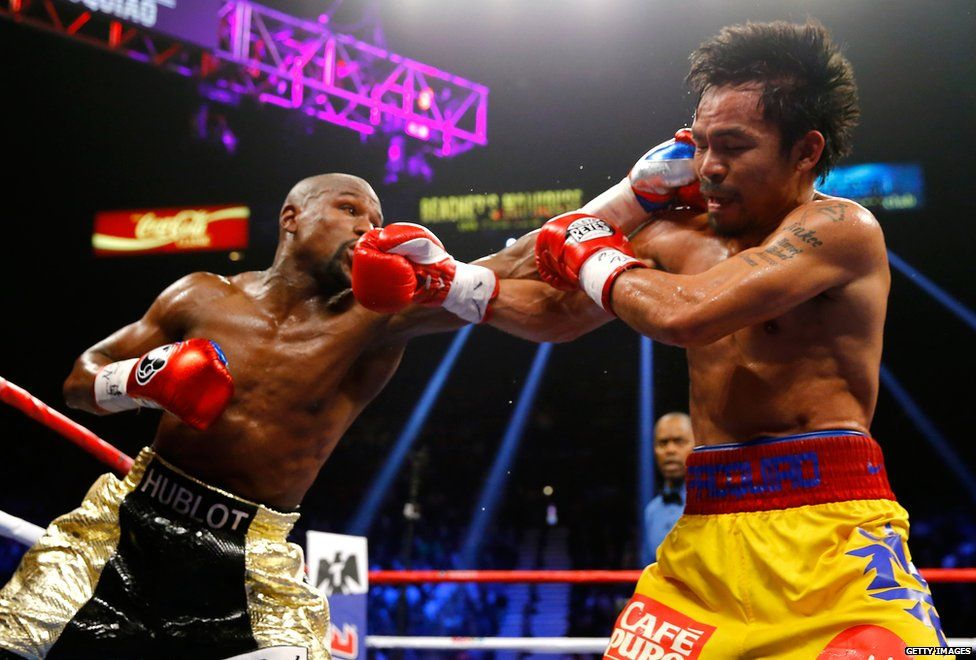 "Floyd Mayweather and Manny Pacquiao exchange punches during the ""fight of the century"""