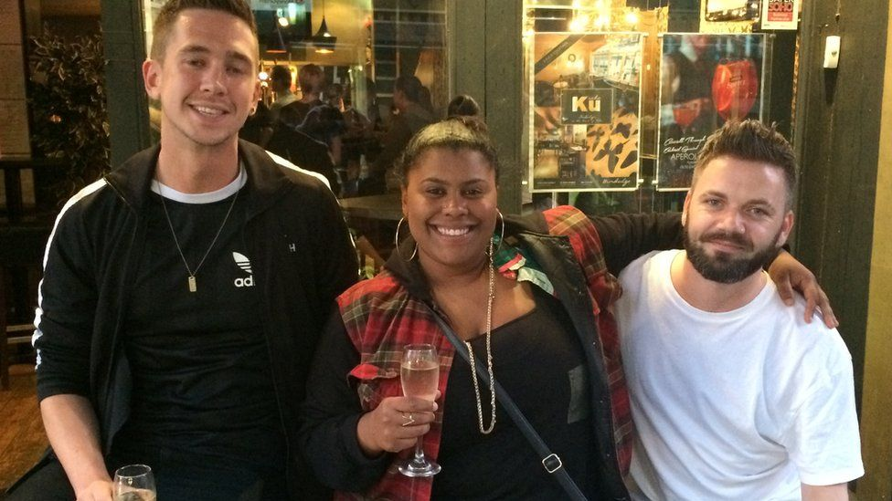 Three friends drinking in Soho, London
