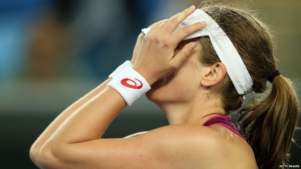 Johanna Konta putting her hands up to her head at the Australian Open