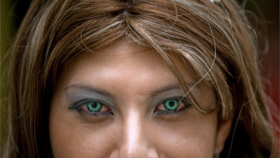 Girl wearing coloured contact lenses