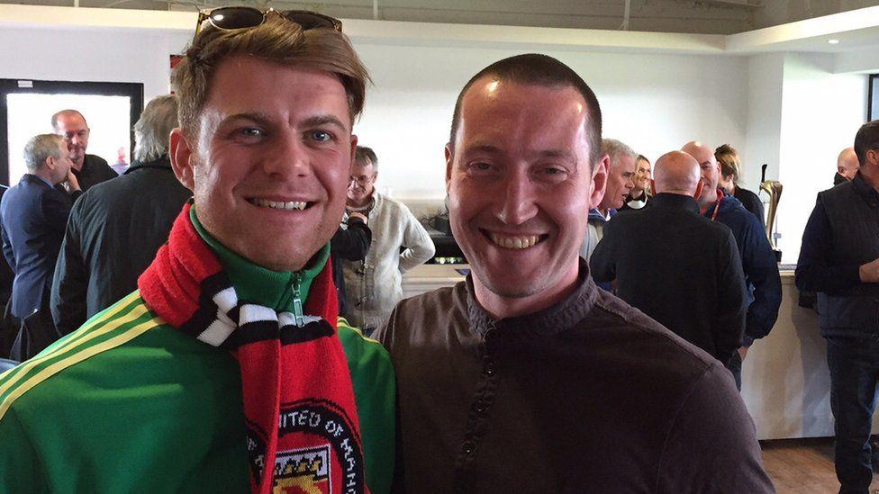 Adam (left) with FC United midfielder Si Carden.
