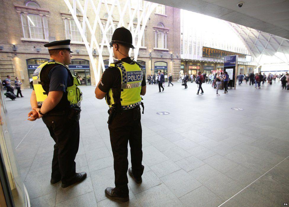 Policemen at Kings Cross station