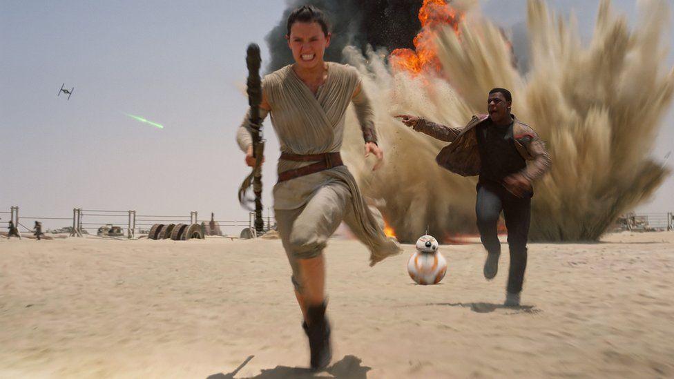 Daisy Ridley as Rey and John Boyega as Finn