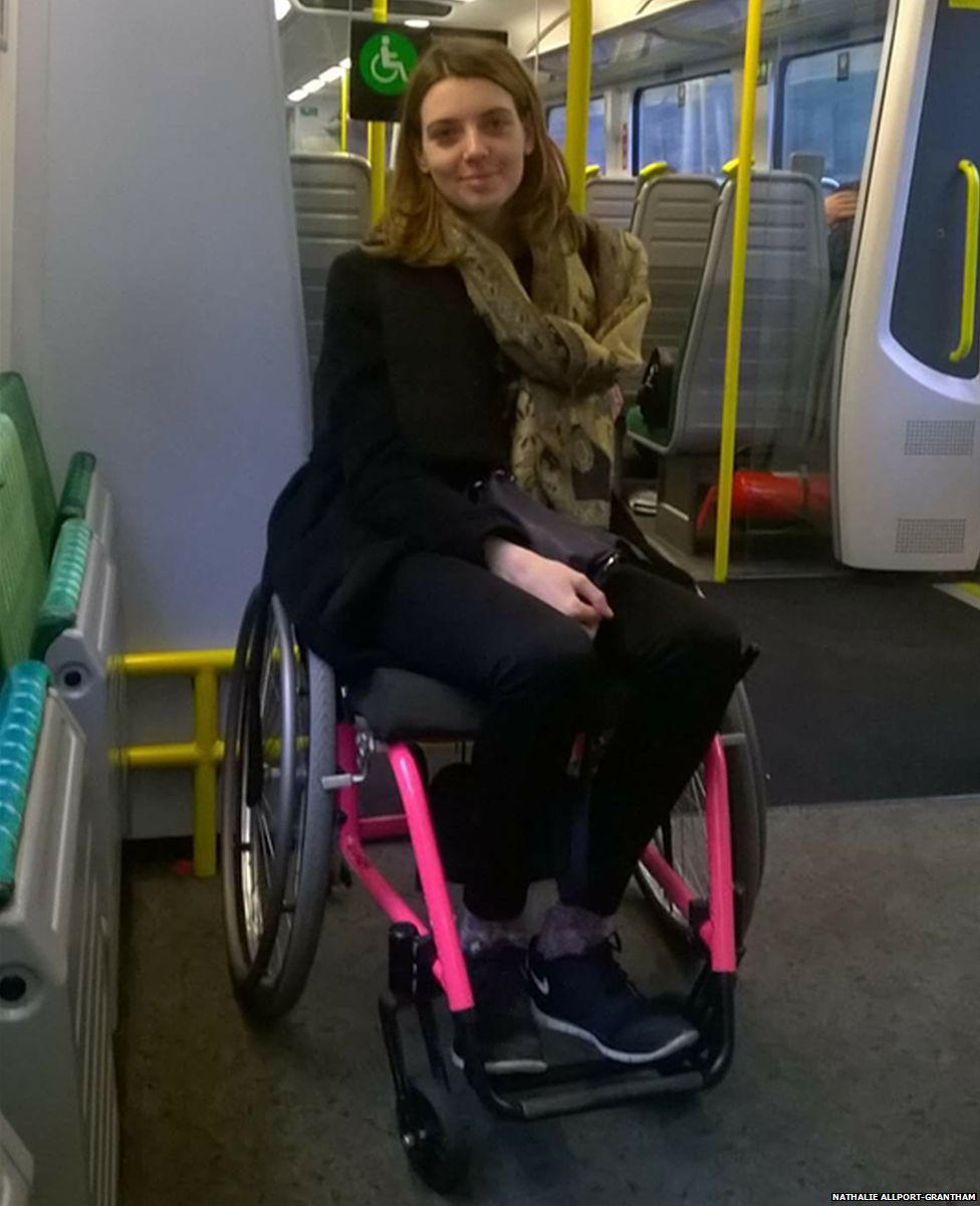 Nathalie in a wheelchair